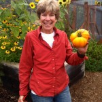 Deane Shokes holds up an heirloom tomato grown at a Los Altos Hills farm.